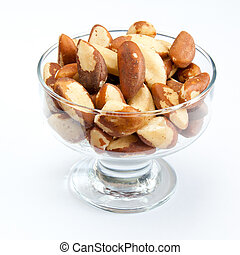 Brasil nuts in the glass bowl on white background