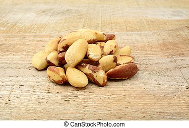 Brasil nuts in the group on wooden plank - Brasil nuts in ...