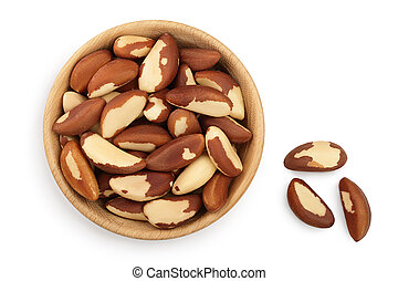 Brasil nuts in wooden bowl isolated on white background with...
