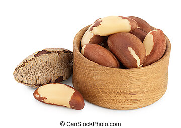 Brasil nuts in wooden bowl isolated on white background with clipping path and full depth of field.