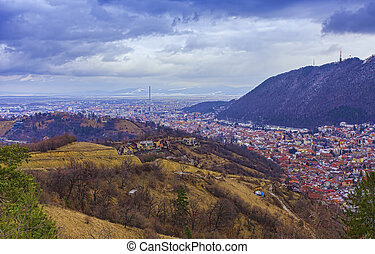 Brasov city panorama view from mountain landscape. Romania
