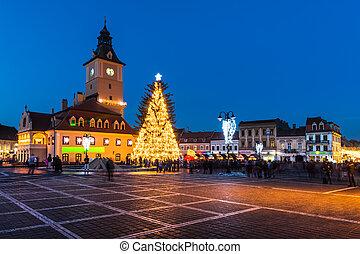 BRASOV - DECEMBER 29. Council Square in 29th December 2013, Brasov, Romania. Historical medieval old city center square of Brasov in Christmas days.