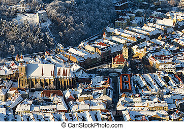 Aerial view of Brasov city in Romania. Brasov is located in the central part of the country and is surrounded by the Carpathian mountains.