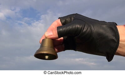 brass bell in hand and sound