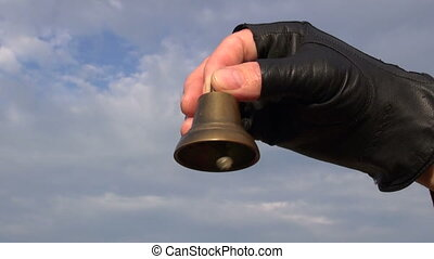 brass bell in hand