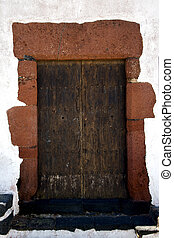 brass brown  door and white wall lanzarote
