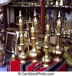Brass coffeepots in Doha - Film image of brass coffepots on...