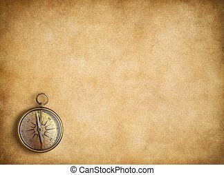 Brass compass on blank vintage paper background - Brass...