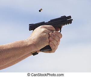 Brass flying from a gun