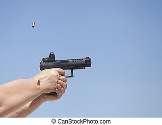 Brass flying from a pistol