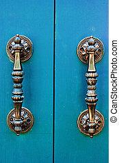brass handle with blue door