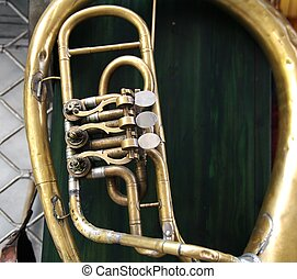 Brass instrument - Old brass instrument with three valves...