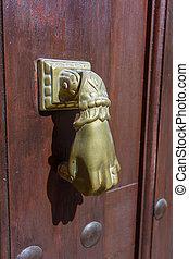 brass knocker on a door
