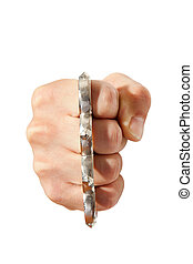 brass knuckles on fist - photo shot of brass knuckles on...