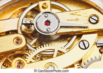 brass mechanical movement of retro watch close up