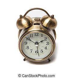 Brass metal alarm clock retro style.