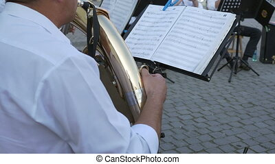 Brass Player Follows Music Sheets - Musician is performing...