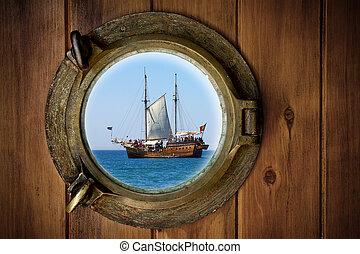 Brass Porthole - Close-up of a boat closed porthole with...
