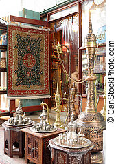 brass pot display - A shop display of traditional metal...