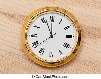Brass small watch or clock on wood table - Small gold...