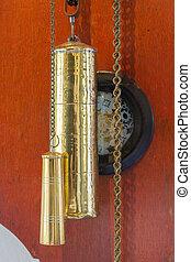 Brass weight on an old dutch clock