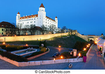 Bratislava castle from parliament at twilight with dramatic...