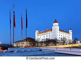 Bratislava castle from parliament at twilight with dramatic ...