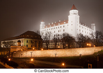 bratislava castle in the fog - illuminated bratislava castle...