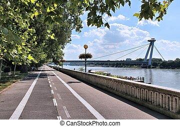 Bratislava, capital city of Slovakia. Danube river waterfront - cycling path along embankment.