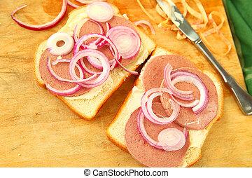 Braunschweiger sandwich preparation with copy space