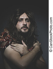 Brave, armored warrior king red skulls, long hair and intense look