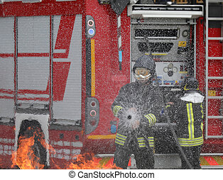 brave firefighter with helmet during the extinguishing of a fire