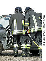 brave firefighters who open the destroyed door of a car using a