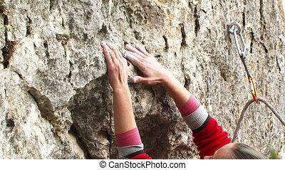 Brave girl - Girl rock climber climbs up the mountain.