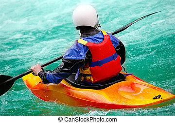 Brave man rides down a wild river kayaking