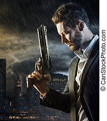 Brave man with dangerous weapon - Brave handsome male agent ...