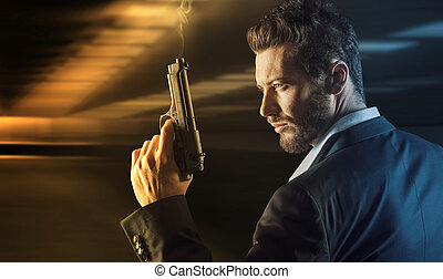 Brave man with handgun - Brave cool man holding a gun on...