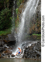 Brave Tourist Baths in Kauai Hawaii Waterfall
