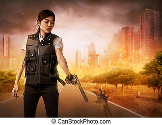 Brave woman with vest shoot the zombies