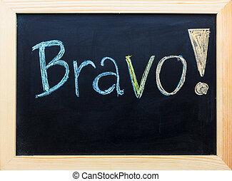 """Bravo"" word on black board."