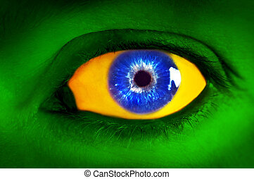 Brazil flag concept. Human eye in colors of Brazilian flag.