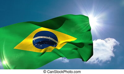 Brazil national flag blowing in the breeze on blue sky...
