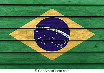 Brazil national flag painted on wood background.
