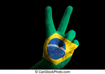 brazil national flag two finger up gesture for victory and winne