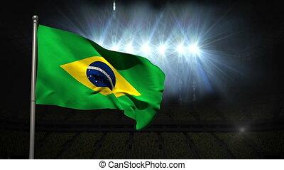 Brazil national flag waving on flagpole on black background...