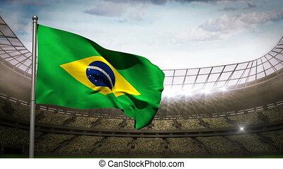Brazil national flag waving on stad