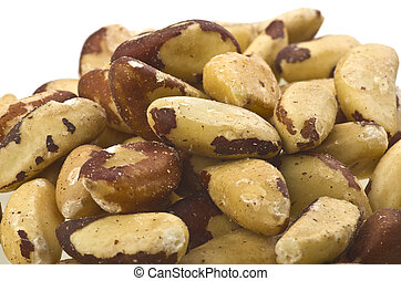 Brazil nuts (Bertholletia excelsa) close up on white