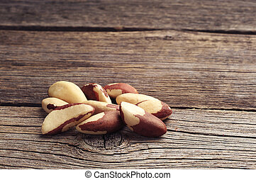 Brazil nuts on wooden background