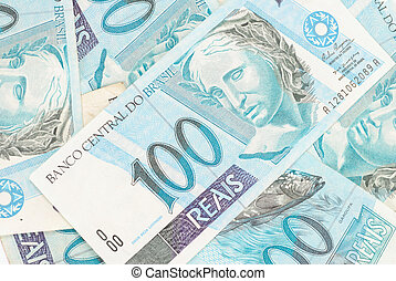 Hundred's of Brazilian real currency background .
