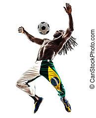 Brazilian  black man soccer player juggling football silhouette